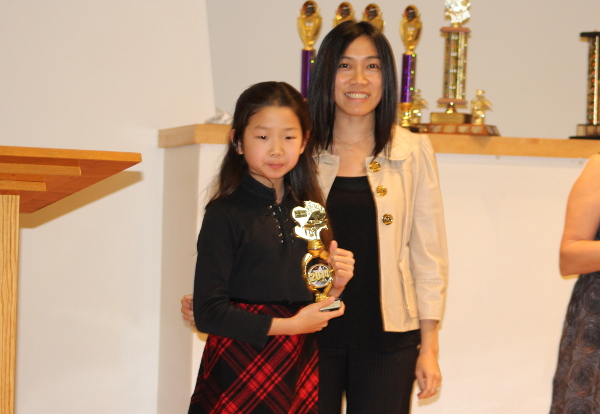 Lancy getting her trophy at the Richmond Music Festival.