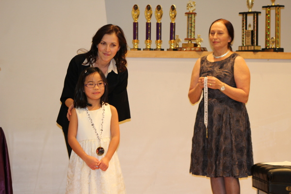 Sophie getting her medal at the Richmond Music Festival.